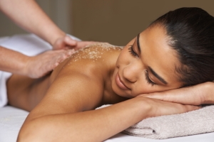 Shot of a young woman enjoying a back massage at a spa